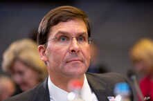 FILE - U.S. Secretary for Defense Mark Esper waits for the start of a meeting of NATO defense ministers at NATO headquarters in Brussels, Oct. 24, 2019.