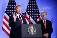 FILE - President Donald Trump, left, is flanked by national security adviser John Bolton, right during a press conference