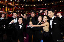 """Bong Joon Ho and the cast of """"Parasite"""" pose at the 92nd Academy Awards in Hollywood, Los Angeles, California."""