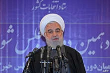 A handout picture provided by the Iranian presidency shows President Hassan Rouhani speaking to the press after casting his vote at a polling station in the capital Tehran, Feb. 21, 2020.