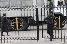 FILE - Police officers guard a court building in Rostov-on-Don, Russia, Sept. 15, 2015. On Monday, a Russian military court in western city of Penza sentenced seven members of a left-wing group to prison terms of up to 18 years on terrorism charges.