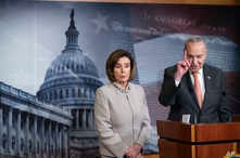FILE - Democratic House Speaker Nancy Pelosi looks on as Senate Democratic Minority Leader Chuck Schumer speaks during a news conference, on Capitol Hill, in Washington, Feb.11, 2020.