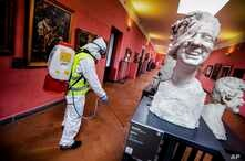 A worker sprays disinfectant as sanitization operations against Coronavirus are carried out in the museum hosted by the Maschio Angioino medieval castle, in Naples, Italy, March 10, 2020.
