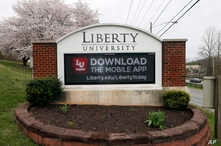 A sign marks the entrance to Liberty University, March 24 , 2020, in Lynchburg, Virginia.