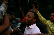 FILE - Prominent Nigerian journalist and activist Omoyele Sowore talks to the media after being released on bail by Nigeria's government, in Abuja, Nigeria, Dec. 24, 2019.