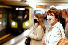 Passengers with face masks wait for a train at the Alexanderplatz underground station in Berlin, Germany, April 27, 2020.