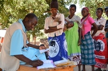 A health worker records information from patient's health passport in Balaka district in southern Malawi. Feared to be carriers of the coronavirus, some medical workers in Malawi have been increasingly shunned. (Lameck Masina/VOA)