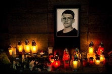 Candles and a portrait of Slovak investigative journalist Jan Kuciak are pictured in front of the Aktuality newsroom in…