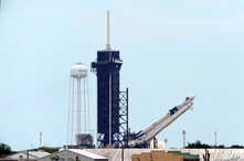 The SpaceX Falcon 9, with the Dragon capsule on top of the rocket, is raised onto Launch Pad 39-A, May 26, 2020.