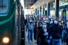 Commuters crowd Cadorna train station in Milan, Italy, May 4, 2020.