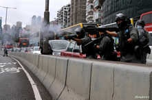 Riot police use rubber bullets to disperse anti-government protesters during a march against Beijing's plans to impose national security legislation in Hong Kong, China, May 24, 2020.