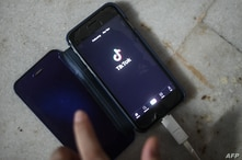 This illustration photo taken on June 29, 2020 shows a person using the video-sharing app TikTok on a smartphone in New Delhi. …