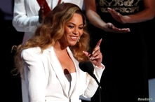 FILE PHOTO: 50th NAACP Image Awards - Show - Los Angeles, California, U.S., March 30, 2019 - Beyonce reacts after winning the…