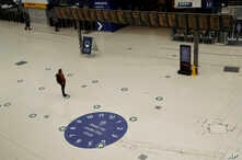 Social distancing guidelines on the floor by train departure information screens to help stop the spread of coronavirus in Waterloo station, London, June 4, 2020.