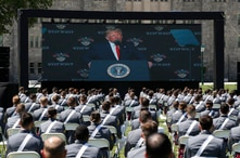 A screen displays President Donald Trump as he speaks to over 1,110 cadets in the Class of 2020 at a commencement ceremony on the parade field, at the United States Military Academy in West Point, N.Y., June 13, 2020.