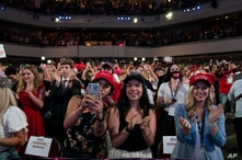 Supporters of President Donald Trump cheer as he arrives to a group of young Republicans at Dream City Church, Tuesday, June 23…