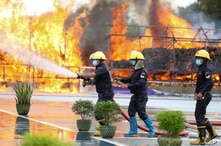 Firefighters spray water as flames and smoke rise from burning illegal drugs during a destruction ceremony to mark…