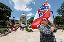 Supporters of the current Mississippi state flag stand outside the state Capitol in Jackson, Mississippi, June 28, 2020.