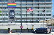 The U.S. Embassy in Seoul displays a Black Lives Matter banner and LGBTQ pride flag, in Seoul, South Korea, June 15, 2020. (William Gallo/VOA)