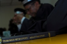 A copy of the Penal Criminal Code instruction manual sits on a desk during a trial in Port-au-Prince, Haiti.