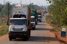 FILE - A convoy of trucks carrying food from the United Nations World Food Programme (WFP) that was stuck at the Cameroon border.