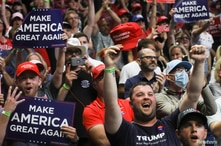 Supporters of U.S. President Donald Trump, most of them not wearing protective face masks, cheer for him