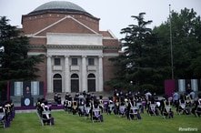 Undergraduate students and university staff wearing face masks attend a graduation ceremony in Tsinghua University, following…