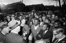 Wilson Baker, left foreground, public safety director, warns of the dangers of night demonstrations at the start of a march in Selma, Alabama, Feb. 23, 1965.