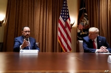 President Donald Trump listens as Robert Unanue, of Goya Foods, speaks during a roundtable meeting with Hispanic leaders in the Cabinet Room, July 9, 2020, in Washington.