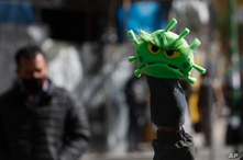A street vendor sells new coronavirus puppets in La Paz, Bolivia, Thursday, July 9, 2020. According to the Ministry of Health…