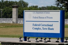 The entrance to the federal prison in Terre Haute, Ind., is shown Monday, July 13, 2020.