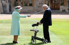 Captain Sir Thomas Moore receives his knighthood from Britain's Queen Elizabeth, during a ceremony at Windsor Castle in Windsor…
