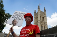 Anti Brexit campaigner Steve Bray holds up a banner outside Parliament in London, July 21, 2020.