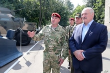Belarus President Alexander Lukashenko, right, inspects police vehicles as he visits the Belarusian Interior Ministry special forces base in Minsk, Belarus, July 28, 2020.