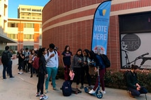 FILE - Young voters wait on line at a polling station at the University of Southern California, in Los Angeles, March 3, 2020.