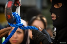 FILE - A member of Iran's special police forces checks the rope before an execution by hanging, in Tehran, Aug. 2, 2007.