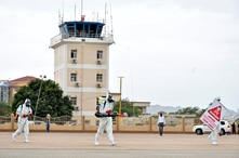 Members of a medical team wearing protective suits clean the airfield to prevent the spread of the coronavirus disease (COVID-19), at the Juba International Airport in Juba, South Sudan, April 5, 2020.