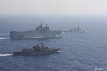 Greek and French vessels sail in formation during a joint military exercise in Mediterranean sea, in this undated handout image…