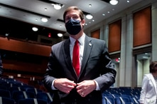 FILE - Defense Secretary Mark Esper leaves after a House Armed Services Committee hearing, July 9, 2020, on Capitol Hill in Washington.