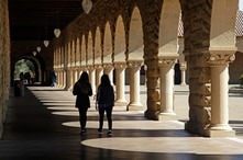 FILE - Students walk on the Stanford University campus in Santa Clara, California, March 14, 2019.