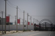 This photo taken on May 31, 2019 shows Chinese flags on a road leading to a facility believed to be a re-education camp where…