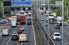 FILE - Traffic moves along the M6 motorway near Birmingham, May 18, 2020. Trade associations call for urgent talks with the government to allay concerns over preparations for Brexit, that may threaten supplies of critical goods caused by border controls.