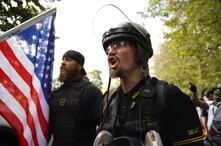 Members of the Proud Boys and other right-wing demonstrators rally on Saturday, Sept. 26, 2020, in Portland, Ore. (AP Photo…