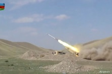 A still image from a video released by Azerbaijan's Defence Ministry shows a multiple rocket launcher of the Azeri armed forces performing strikes during clashes over the breakaway region of Nagorno-Karabakh in Azerbaijan, Sept. 30, 2020.