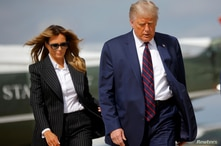 U.S. President Donald Trump and first lady Melania Trump board Air Force One as they depart Washington.