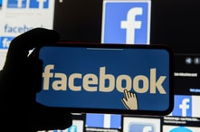 FILE - The Facebook logo is displayed on a mobile phone in this picture illustration.
