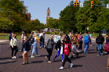 FILE - In this Sept. 10, 2020, file photo, masked students cross an intersection on the campus of Ball State University in…