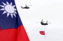 Helicopters fly over President Office with Taiwan National flag during the National Day celebrations in Taipei, Taiwan, Oct. 10, 2020.