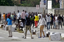 Young people protest at the Lekki toll gate in Lagos, Nigeria, Oct. 21, 2020. The Lekki toll gate was the site where demonstrators were fired upon earlier in the week in an escalation that sparked global outrage.