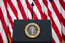 FILE - The presidential podium and seal are seen before an event in the South Court Auditorium of the White House complex, in Washington, July 24, 2020.
